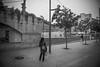 Singing under the rain. (A.Ayuso) Tags: blanconegro calle callejeros candid candidphoto españa lleida nikon noiretblanc rue streetphotography streetshoot schwarzweiss spain strasse strase street urbana invierno paseo walking winter