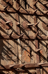 Ancient History (peterkelly) Tags: digital canon 6d india asia orchha jahangirmahal spikes spike bent door wooden detail old metal rust rusty