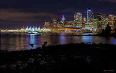 Across The Harbour (Clayton Perry Photoworks) Tags: vancouver bc canada winter explorebc explorecanada night lights stanleypark canadaplace skyline reflections city