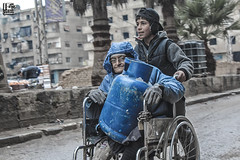 """This is our third try to fill it with gas this week"" (Take a look on Syria without propaganda) Tags: gas siege besiege syria human rights humanity assad forces russia eldery old children child childhood"