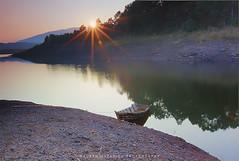 Barapani Lake Sunrise (hazarika) Tags: india sunrise boat meghalaya sunstar barapani canon50d canon1635mmf28liiusm barapanilake mausamhazarikaphotography