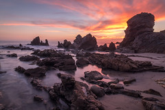 Resiliance (mark5photographic) Tags: seascapes sea sunset ocean orange rocks coast outdoor water california clouds landscape light beach