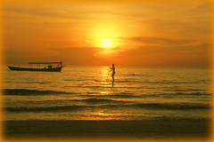 on the board (hatschiputh) Tags: otres beach cambodia sunset woman lady ses golden water board