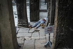 Angkor nap (jrockar) Tags: streetphoto streetphotography street candid moment instant snap man sleeping angkorwat cambodia travel trip journey oncearoundthesun jrockar janrockar idiot ruins angkor barefoot noentry resting nap vat ancient historical site canon 5d mk mark iii 3 l 1740