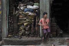 Young responsibility (Photosightfaces) Tags: young boy sri lanka lankan srilanka srilankan metal parts maradana colombo