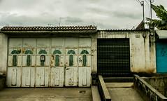 Hospitality (BradPerkins) Tags: guatemala building decay rust urbandecay urbanlandscape abandoned abandonedhouse shut rusty trip gate neglected lines thanksgiving2016 antigua urban village travel