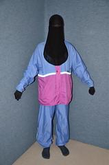 Aqua Guard raincoat and Niqab (Buses,Trains and Fetish) Tags: girl aqua coat guard niqab raincoat anorak slave burka chador hjiab