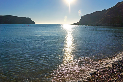 Sun reflecting in Lulworth Cove