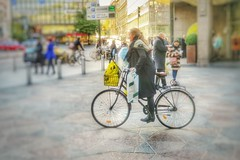 Cycling away with the shopping bags (polnamara) Tags: street girl canon finland shopping cycling helsinki october europe cyclist north saturday baltic nordic northern 2015 g7x stockhmann 10october2015