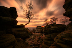 Brimham Rocks Sunset (Andy Watson1) Tags: park uk trip travel winter light sunset shadow england tree english andy silhouette rock clouds canon landscape photography evening countryside photo scenery rocks long exposure view cloudy britain yorkshire united great scenic sigma kingdom scene erosion formation national watson british nationaltrust brimham dales brimhamrocks 450d