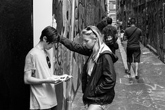 Places to go, stuff to see (midgley.derek) Tags: street people woman man tourism photography graffiti book candid union streetphotography melbourne planning lane dsc00168