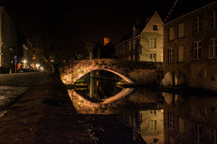 Whispers in the dark... (Gilderic Photography) Tags: city bridge reflection water canon dark eos lights canal arch belgium belgique brugge reflet pont bruges nuit ville 500d gilderic