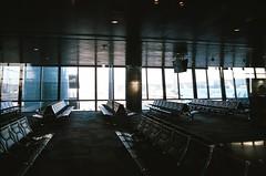Doha (ijarosek) Tags: morning film window 35mm gold dawn early airport chairs kodak iso international 200 lonely praktica hamad doha qatar tl5b gold200 prakticatl5b