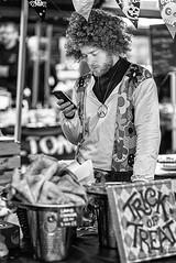 Trick or Treat By Phone (Geoff France) Tags: street streetphotography market streetmarket monochrome mono blackandwhite candid urban urbanartlowrymakers salford