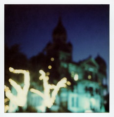 Courthouse-on-the-Square Bokeh (tobysx70) Tags: the impossible project tip polaroid sx70sonar sonar instant color film for sx70 type cameras impossaroid courthouseonthesquare bokeh denton texas tx twilight outoffocus oof lit illuminated night nocturnal trees fairy christmas lights clock tower silhouette polacon2016 polaconone 100116 toby hancock photography