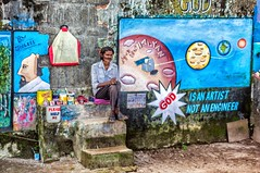 Gallery (gecko47) Tags: painter artist jaleel display gallery paintings art stonewall fortcochin kochi kerala india waterfront fishingnets streetart socialcommentary environment religion chalkandpaintmix