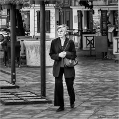 Lost (John Riper) Tags: johnriper street photography straatfotografie square vierkant bw black white zwartwit mono monochrome hungary budapest candid john riper fujifilm fuji xt1 18135 woman lady handbag lost terrace
