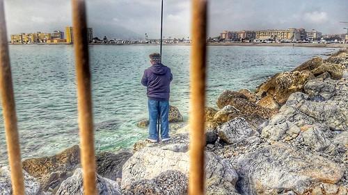 Un dia de pesca.El Espigon, playa de la Misericordia. Malaga.