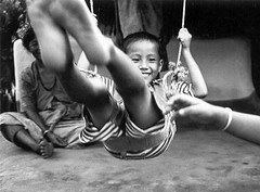 Playing happily on a swing