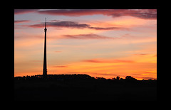 Sunset over Emley (littlestschnauzer) Tags: uk autumn light red sun sunlight west silhouette rural landscape nikon skies village yorkshire landmark structure september tall mast moor setting emley 2015