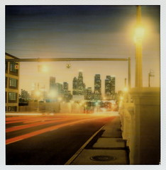 Into The Twilight Zone (tobysx70) Tags: california ca street bridge blue autumn light sunset toby 2 test color fall film lamp skyline night project polaroid sx70 for la los twilight october downtown cityscape skyscrapers traffic angeles dusk trails 4th illuminated tip cameras hour type instant week lit 20 hancock day5 gen pioneer generation tigerstripes dtla zone taillight highrises impossible roid the gen2 2015 0515 polaroidweek into roidweek tobyhancock impossaroid