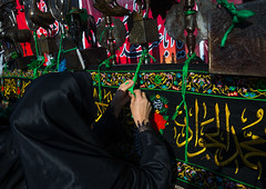 iranian shiite women putting green ribbons on an alam to make wishes during chehel menbari festival on tasua day, Lorestan Province, Khorramabad, Iran (Eric Lafforgue) Tags: people metal horizontal female religious outdoors hope persian women mourning adult iran symbol muslim traditional text prayer praying banner middleeast culture happiness knot fortune celebration shia ritual muharram ashura ribbon spirituality wish tied calligraphy script tradition hussein oneperson alam wishing iman shiite ashoura hussain mourner persiangulfstates onewomanonly إيران иран 16838 tasua husayn colourimage イラン irão shiism arabicalphabet khorramabad 伊朗 tasoua unrecognizableperson westernasia 이란 lorestanprovince
