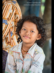 Young Khmer girl with curly hair, Siem Reap, Cambodia (jitenshaman) Tags: travel girls cute girl smile female asian happy kid asia cambodia cambodian khmer child market curly destination siemreap hairstyle curlyhair funy worldlocations psarleu