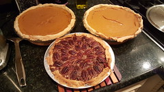 Two pumpkin pies and a pecan pie
