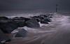 Hayling Island Evening (Aaron_Bennett) Tags: aaronbennett haylingisland sandypoint landscape nature water sea motion rocks sky clouds gloomy darkclouds dark fujifilm xt1 xf1024mm leefilters vscofilm