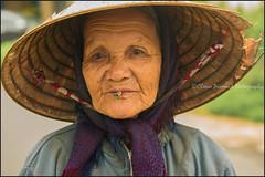 Cigarette.  Hoi An (Claire Pismont) Tags: asie asia pismont portrait nónlá chapeauconique clairepismont cigarette smoking streetshot documentory vietnam travel
