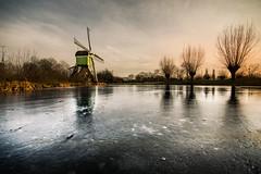 icy scenery (bjdewagenaar) Tags: winter ice sun dutch gorinchem gorcum windmill trees landscape waterscape sky wide angle sigma 1020mm 10mm sony a58 alpha raw lightroom