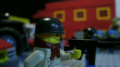 Lego World War II US Soldier (Force Movies Productions) Tags: lego minfig military world war ii wwii toy screenshot photograpgh frame photo photograph brickarms brickizimo mashine gun rifle soldier smiling behind helmet scene youtube army toys rebel rebellion resistance
