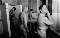 Patrons clean up in the Harjuntori public sauna, Helsinki, Finland