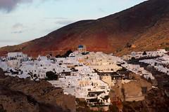 Crimson (Nagarjun) Tags: blue sunset sun white church island volcano evening europe glow santorini caldera oia cyclades mediterranian firostefani aegeansea