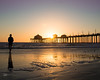 Beach (Miiksterr) Tags: canoneos rebelt5 1855mm beach girl silhouette hb sunset orange filter purple blue ocean pacificocean california cold windy relax sun shine colors outdoors pier
