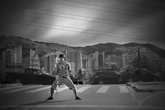 Malabares (CarlosKiffer) Tags: bw city people performer street cars sky