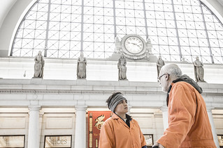 Chantal de Alcuaz and Mike Fiala Converse in the Lobby at Union Station