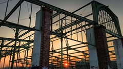 Sunset at the old cattle vault (ANBerlin) Tags: linien lines ruine ruin stahl steel sonne sun besonders special eisengerüst architektur architecture framework iron hammelauktionshalle blankensteinpark historisch historical denkmalschutz protection monument prenzlauerberg himmel sky heaven halle hall gebäude building alt old auktionshalle entrancehall rinder cattle drausen outdoor abends evening sonnenstrahlen sunbeams sonnenuntergang sunset abstrakt abstract symmetrie symmetry rahmen frame ausergewöhnlich extraordinary deutschland germany berlin friedrichshain zurrinderauktionshalle anb030 shotoniphone iphotography iphonography 6splus iphone6s iphone apple