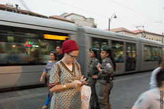 jetuslam train goes by (barak.shacked) Tags: street woman train soldier jerusalem streetphotography police cop policewoman ירושלים borderpolice