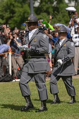 Confederate Flag Removed from South Carolina Capitol Grounds (Richard Ellis Photography) Tags: usa vertical america unitedstates symbol massacre flag unitedstatesofamerica capital ceremony southcarolina columbia confederate capitol crime folded lower hatred removal racism racist civilrights ame symbolic carrying statehouse policemen lowering honorguard statepolice highwaypatrol battleflag massmurder charlestonnine emanuelafricanmethodistchurch