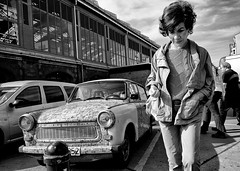 Vintage (enzo marcantonio) Tags: street leica people blackandwhite woman berlin car one 21 streetphotography enzo lonely mm facial trabant biancoenero berlino 21mm facialexpression marcantonio enzomarcantonio workshopontheroad