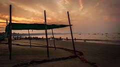 Shelter Stories - Visakhapatnam, India (Kartik Kumar S) Tags: street sunset sea orange sun india net beach colors clouds canon landscape photography dawn fishing fisherman hour shelter nets incredible maharastra 600d malwan