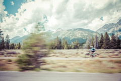 Biker in Grand Teton (ExceptEuropa) Tags: park travel sky panorama usa cloud mountain sports nature bike canon landscape photography nationalpark photographer cyclist unitedstates nps roadtrip biker alta wyoming traveler grandtetonnationalpark canon6d