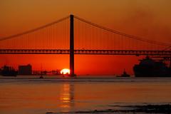 sunset in lisbon (tamasmatusik) Tags: sunset lisbon lisboa lisszabon portugal portugália bridge sun autumn november cityscape naplemente sonnenuntergang tejo river dusk sonynex sundown nex3n milc 165mm alfama