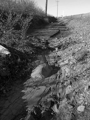 Erosion.. (Bubash) Tags: water rocks erosion dirt roadside
