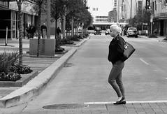Blonde Bun (burnt dirt) Tags: houston texas downtown town city mainstreet street streetphotography building wall people person girl woman bw cold coldweather walk walking purse blonde bun