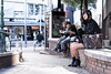 Sitting pretty in Triangle Park (Eric Flexyourhead) Tags: amerikamura amemura アメリカ村 chuo chuoku 中央区 osaka osakashi 大阪市 kansai 関西地方 japan 日本 trianglepark city urban street streetphotography candid streetcandid girl woman sitting cute kawaii かわいい sonyalphaa7 zeisssonnartfe55mmf18za zeiss 55mmf18