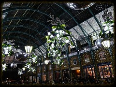 Indoor snow? (Englepip) Tags: coventgarden indoor market glitterball decorations christmas mistletoe baubles night london lamps shops atmospheric delight winter architecture