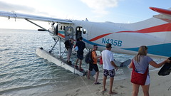 Unloading the seaplane at Dry Tortugas National Park (lhboudreau) Tags: drytortugas drytortugasnationalpark outdoor coast shore nationalpark park tortugas island islandpark seaplane people unloading pontoon pontoons dehavillanddhc3otter otter dehavilland aircraft airplane plane water ocean gulf gulfofmexico beach sand propeller