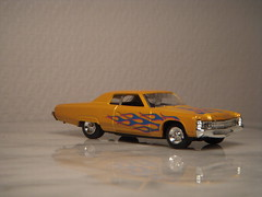 1971 Chevrolet Impala Custom Coupe 1:64 Diecast by Motormax (PaulBusuego) Tags: 1971 chevrolet impala custom coupe 164 diecast by motormax sports sedan belair caprice biscayne pontiac parisienne buick oldsmobile cadillac 4 door hardtop bodyonframe rear wheel drive rwd v8 traditional american usa bbody b platform fullsize artisan made china scale model toy car replica metal plastic vehicle lines miniature muscle photography general motors gm us america personal luxury 1970